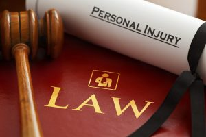 "Gavel, law book, and paper with the text ""personal injury"""