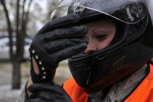 Motorcyclst checking right glove