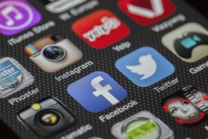 Various smart-phone app social media icons, including Instagram, Facebook, and Twitter