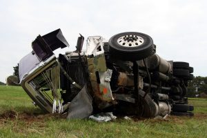 An overturned and badly damaged semi truck