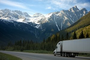A semi-truck driving in the mountains