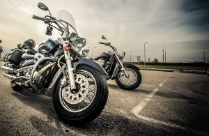 Two motorcycles parked on the street