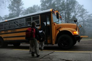 Children getting on a school bus
