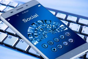 A phone with social media apps diplayed