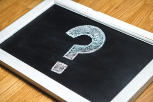 A chalkboard with a question mark drawn on it