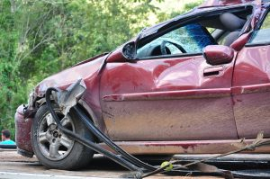 A severely damaged red car
