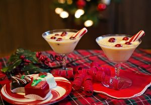 A holiday spread with martini glasses of eggnog