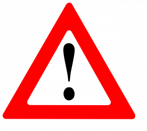 An exclamation point in a red triangle