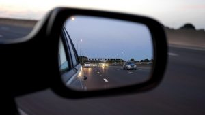 side mirror of a car showing highway