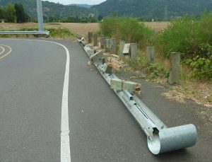 damaged crash barrier at the roadside