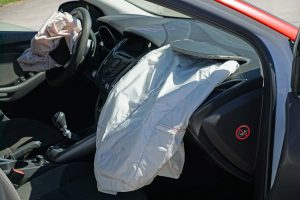 crashed car with airbags deployed