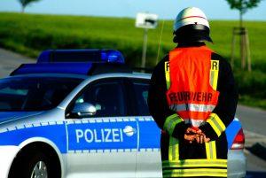 emergency worker standing near emergency vehicle