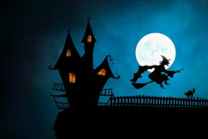 An illustration of a witch riding on a broom
