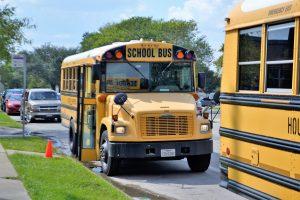 School buses picking children up