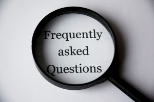 """The words """"Frequently Asked Questions"""" in a magnifying glass"""